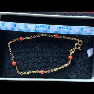 Gold bracelet with coral beads